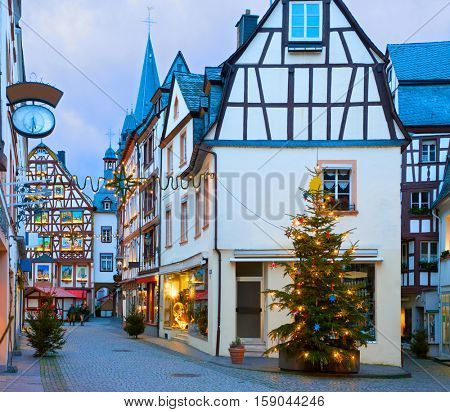 Old street  decorated for Christmas in the historic center of Bernkastel-Kues, Rhineland-Palatinate, Germany. Toned image