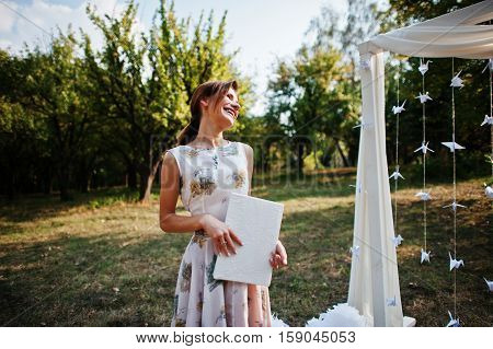 Ceremony master on wedding ceremony outdoor near arch