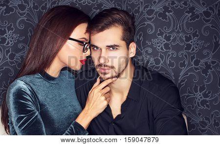 Young sexy man seducing smart girl in club