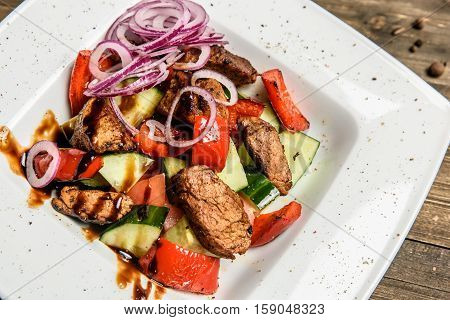 Salad of chicken breast with zucchini and cherry tomatoes.