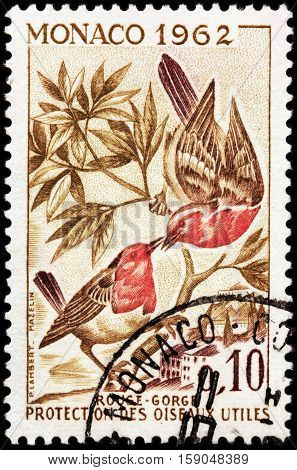 LUGA RUSSIA - NOVEMBER 29 2016: A stamp printed by MONACO shows European Robin (Erithacus rubecula) known simply as robin or robin redbreast - a small insectivorous passerine bird circa 1962