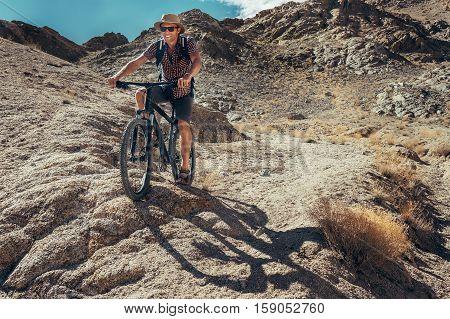 Bike traveler rides on mountain race .