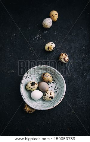 Quail eggs in a bowl. Farm products, bio product, food concept, top view.