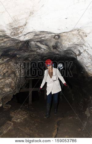 Woman walks out of Lepenica cave in Bulgaria in the fall