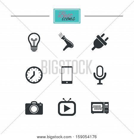 Home appliances, device icons. Electronics signs. Lamp, electrical plug and photo camera symbols. Black flat icons. Classic design. Vector