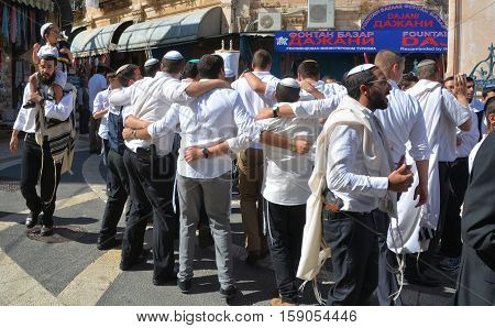 JERUSALEM ISRAEL 26 10 16: Jewish men celebrate Simchat Torah. Simchat Torah is a celebratory Jewish holiday marks the completion of the annual Torah reading cycle