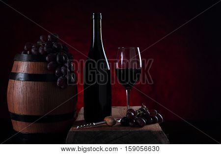 Bottle with sweet red vine. Old barrel with vine