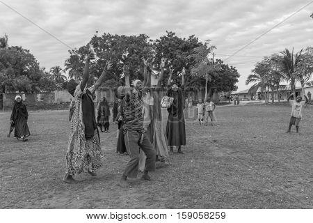 ZANZIBAR, TANZANIYA- JULY 16: african playing children with hands upon July 16, 2016 in Zanzibar. black and white photo