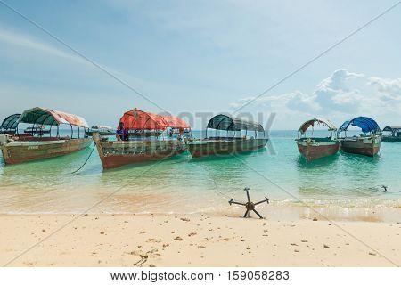 ZANZIBAR, TANZANIYA- JULY 12: anchores from touristic boats on sandy beach on July 12, 2016 in Zanzibar