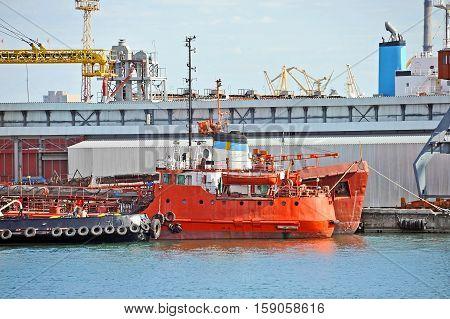 Bunker ship and tugboat under port crane Odessa Ukraine