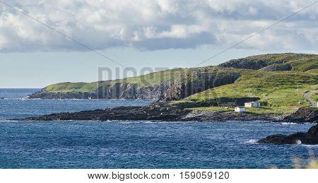 Ellistion cliffs, Newfoundland, hillsides and shoreline.   Rocky coastline in Elliston village along the coast fingers of the Island of Newfoundland, Canada.