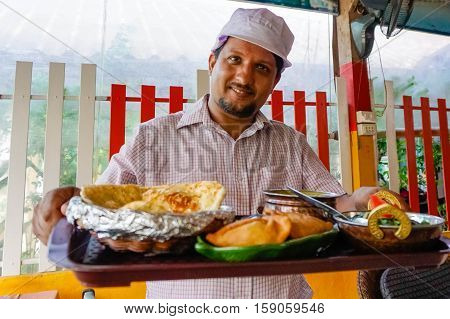 Indian chef serving food on Sony a6300 29, 9 fps HD