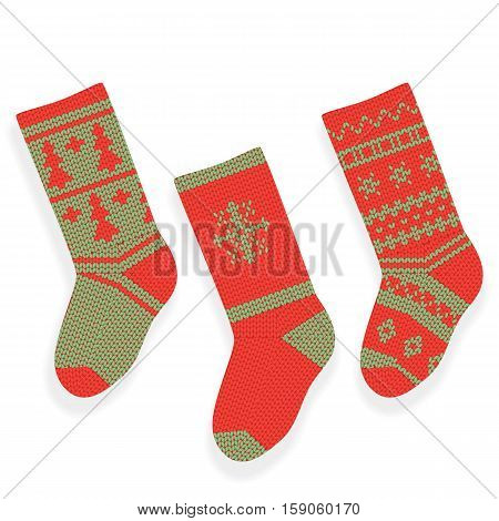Green and red christmas knitted stocking isolated on white background.