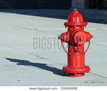 Red Fire Hydrant casting a shadow on the sidewalk