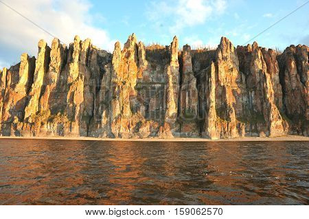 Lena Pillars. Tall cliffs, completely solid wall stretching along the right bank of the Lena four dozen kilometers. One they resemble huge walls of a medieval castle, while others remember the dragon fangs, a third think that in front of them forever froz