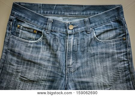 close up background and Texture of repair sew for old dark blue denim jeans