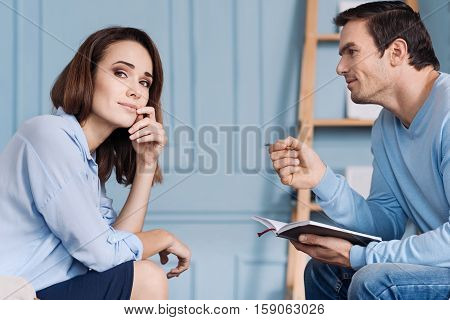 I feel better now. Professioanl handsome psychotherapist sitting in the arm chair and talking with his patient