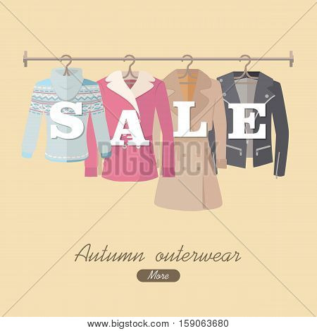 Autumn sale vector web banner. Flat design. Women s jacket, coat, cloak, sweater hanging on the hangers. Seasonal discounts in clothing store concept. For boutique promotions landing page design