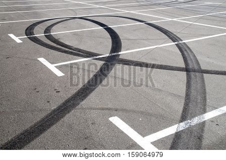 Trace of motorcycle tire on the asphalt in a parking lot