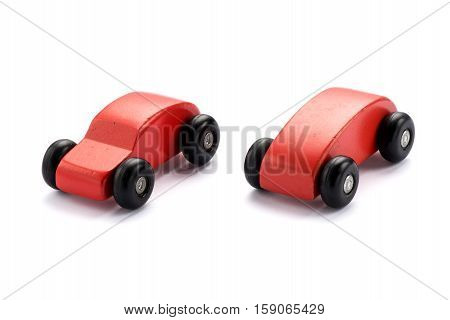 Two Stylized Wooden Toy Cars For Kids