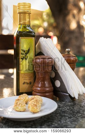 Table set with olive oil, pepper and salt shaker, cookies