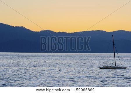 Silhouette of a sailing boat in summer evening on Lake Tahoe