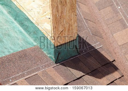 Clos up of tiled roof with shingles and vapor control layer membrane