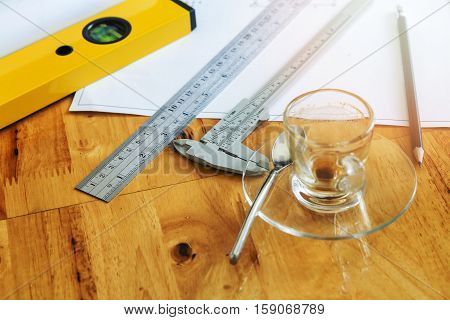 Measurement tool and empty cup of coffee