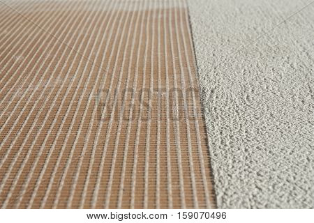 microcement thick preparation layers above stoneware floor covering microtopping coating whit fiberglass mesh