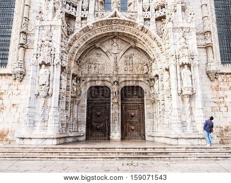 LISBON PORTUGAL - NOVEMBER 24 2016: Doors of the Santa Maria Church in Jeronimos Monastery Lisbon Portugal.