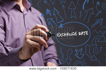 Technology, Internet, Business And Marketing. Young Business Man Writing Word: Exchange Rate