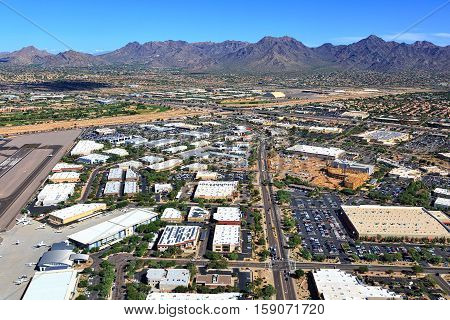 Economic growth in Scottsdale Arizona along the Loop 101 freeway and the airport viewed from above