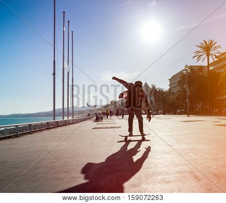 Silhouette Of Skateboarder In City