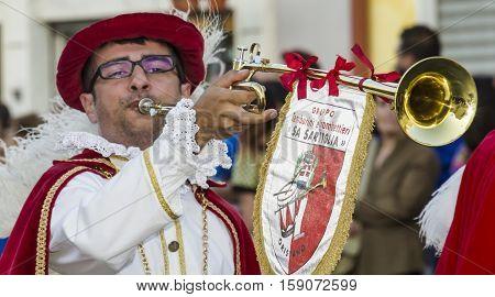 QUARTU S.E., ITALY - July 12, 2014: 28 ^ parade Sciampitta - Sardinia - portrait of a musician of the flag wavers of Oristano