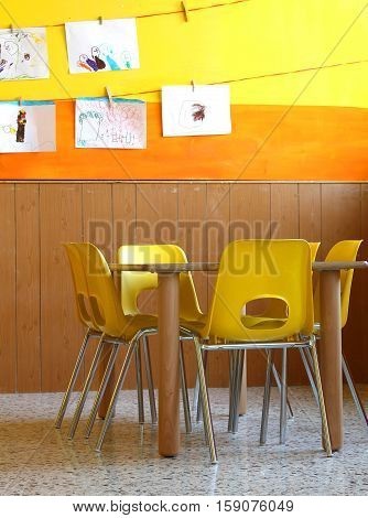 Table And Yellow Chairs In The Classroom