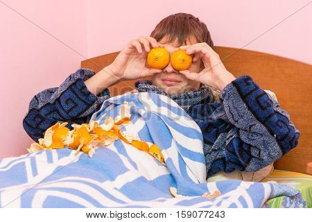 Man Lying In Bed And Funny Tangerines Closed Eyes