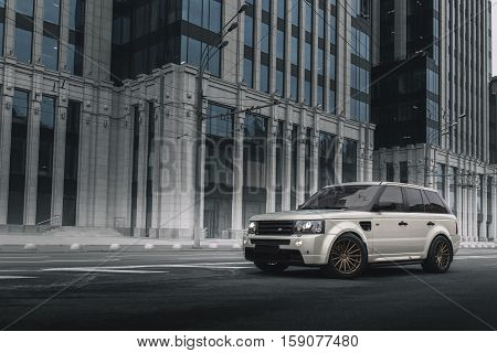 Moscow, Russia - October 23, 2016: Car Land Rover Range Rover Sport parked near modern building in Moscow at daytime