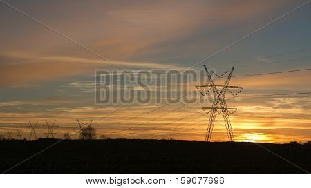 Power Pylons against the sunset at fall