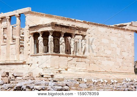 View on Temple of Athena Nike Athens in Acropolis with blue sky and clouds on the background. Athene Greece.