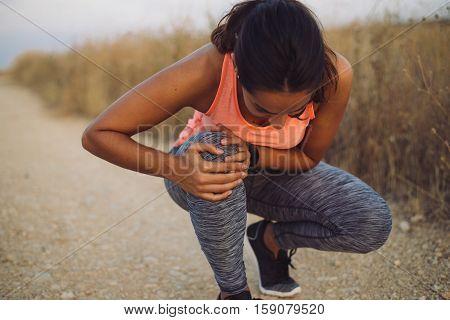 Female Runner Suffering From Knee Injury