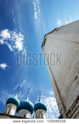 Gorokhovets Vladimir region. A belltower and domes of Annunciation Cathedral against the background of the blue sky