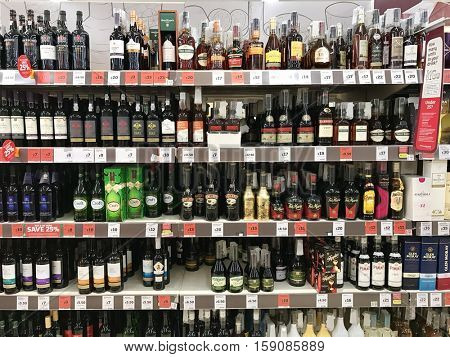 LONDON - NOVEMBER 29: Liquor stocked aisles in Sainsburys Finchley Road on November 29, 2016 in London, UK.