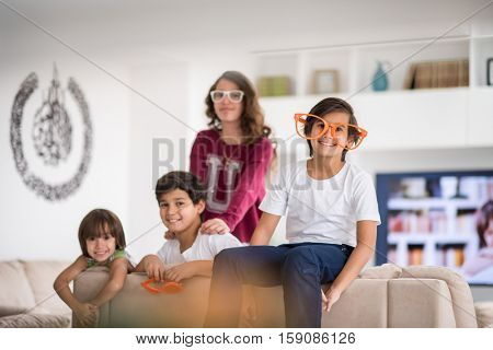 Funny kids with silly glasses on eyes at home