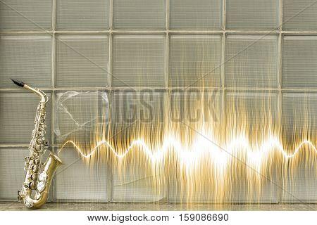 Jazz saxophone with sound wave by glass windows