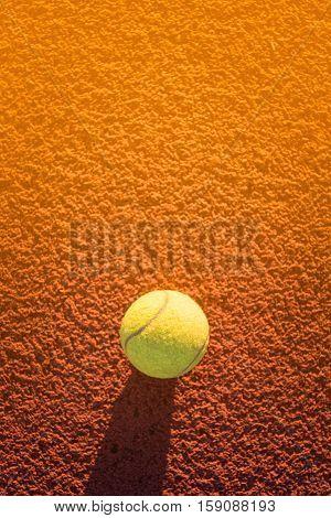 Close up of tennis ball on clay court./Tennis ball, Tennis sport, Tennis ball green color, Tennis concept, Tennis court, summer tennis