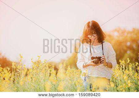 Young Woman With Camera In The Sunhemp Garden