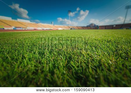 Green grass in soccer stadium at Thailand.