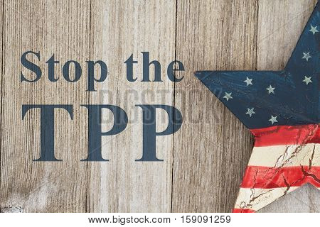 Stop the TPP message USA patriotic old flag on a star with weathered wood background with text Stop the TPP
