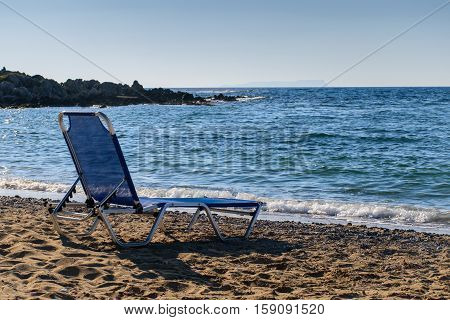Chaise and the sea. Beauty of nature.