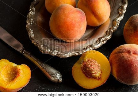 Ripe And Juicy Peaches On A Dark Background.